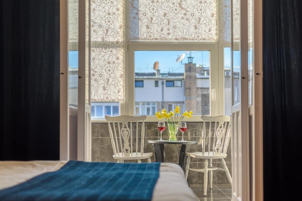 Apartament typu Premium, 3 sypialnie, kuchnia, widok na miasto - Pokój