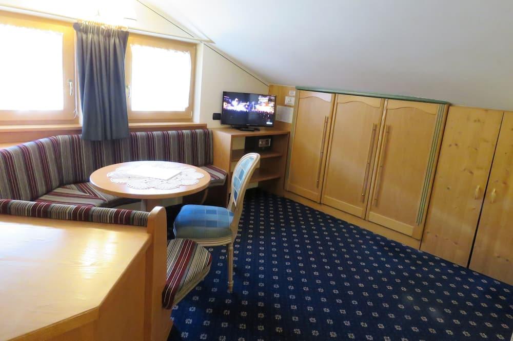Chambre Quadruple - Restauration dans la chambre