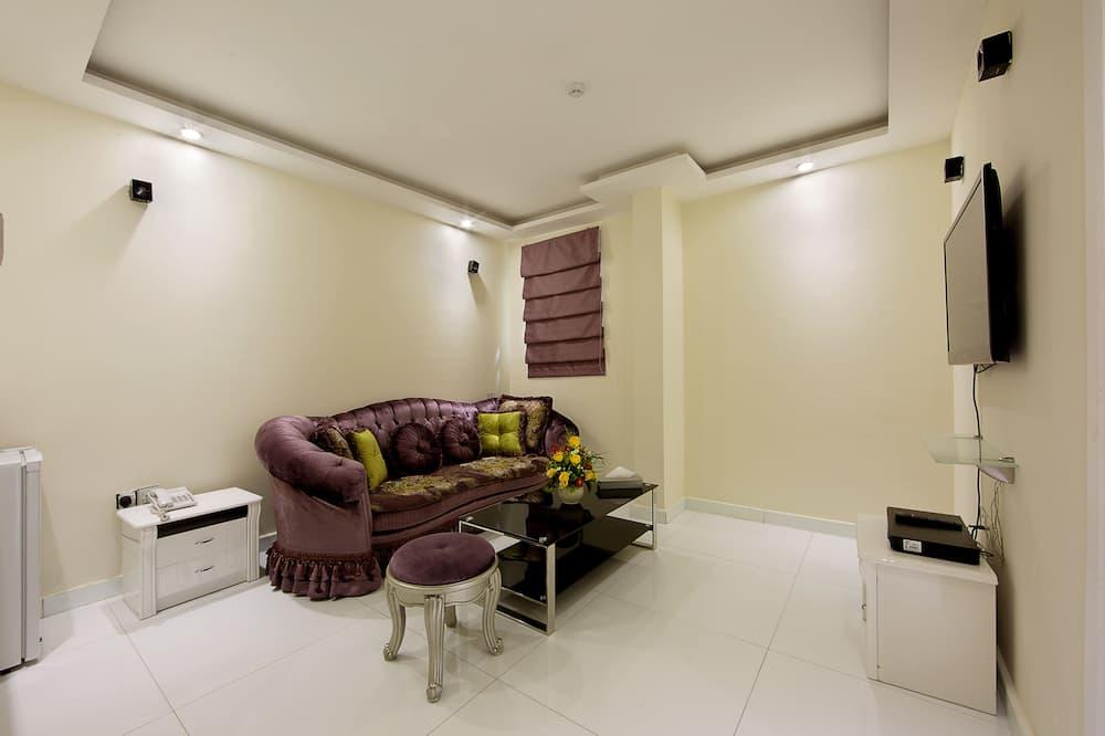 Familien-Suite, 1King-Bett und Schlafsofa - Wohnbereich