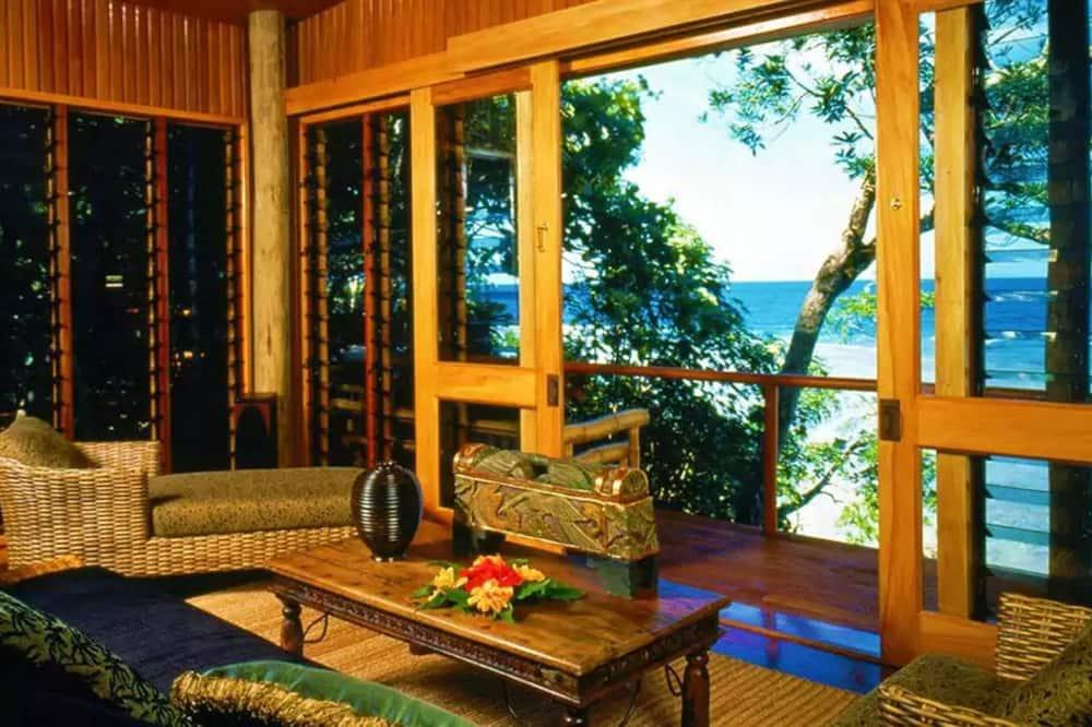 Traditionel bungalow - 1 kingsize-seng - havudsigt - Opholdsområde