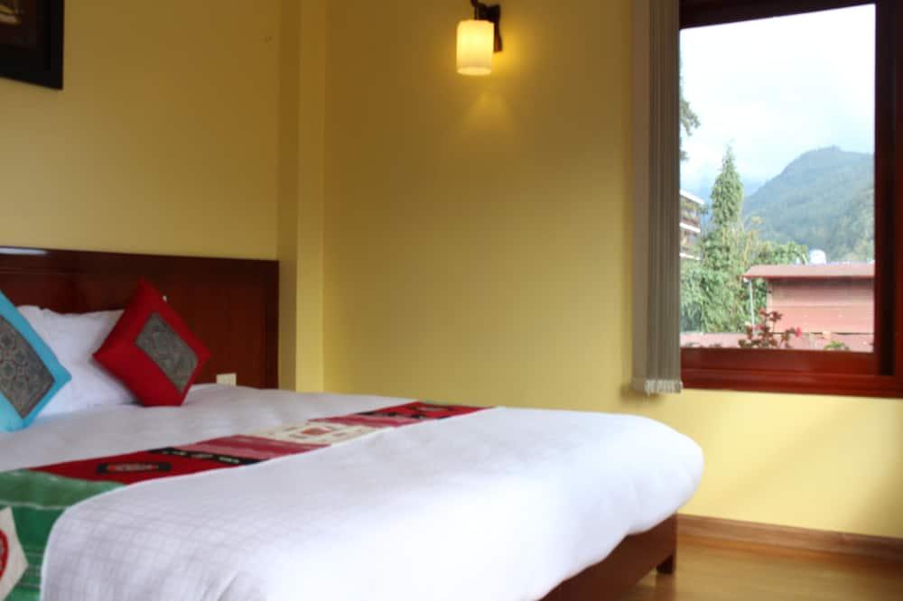 Pokoj Deluxe s dvojlůžkem, výhled na hory - Obývací pokoj