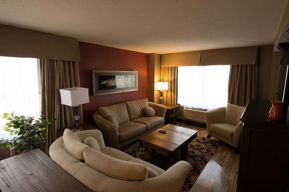 جناح - سرير ملكي - غرفة معيشة
