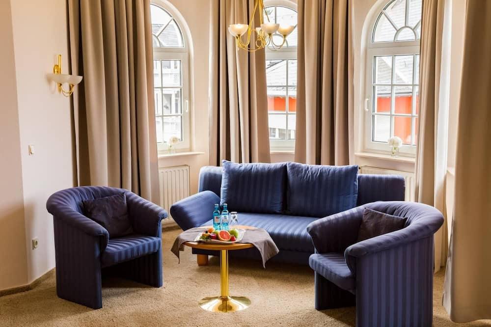 Žemesnės liukso klasės numeris, 1 standartinė dvigulė lova ir 1 sofa-lova - Svetainė