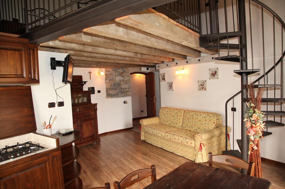 Rodinné apartmá, balkon - Obývací prostor