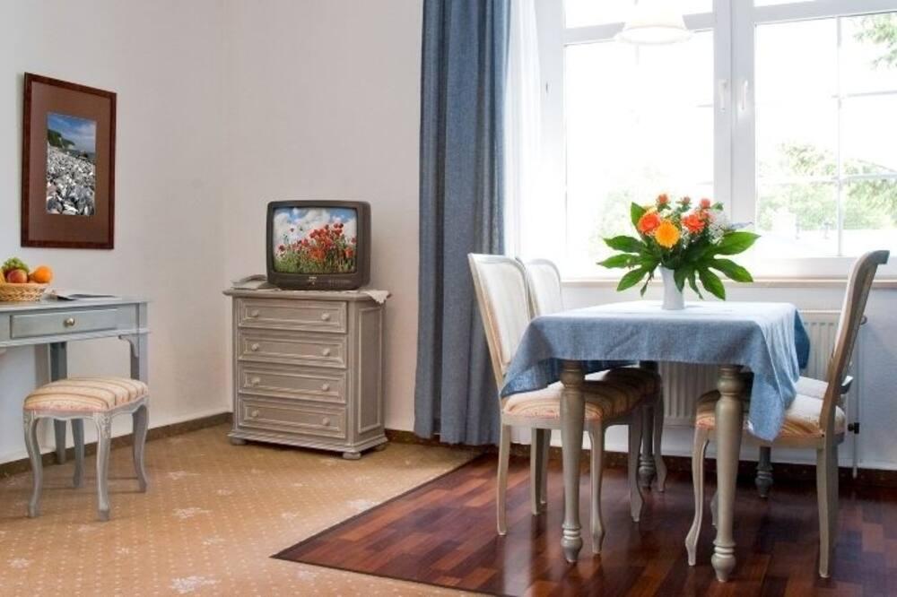 Suite, coin cuisine - Restauration dans la chambre