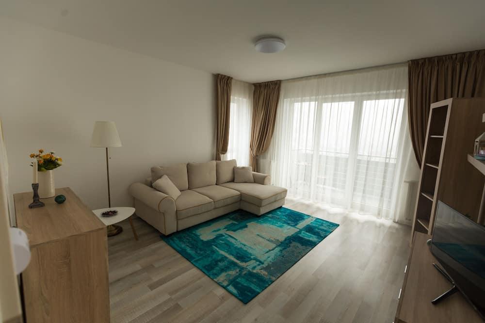 Apartamento Confort - Zona de estar