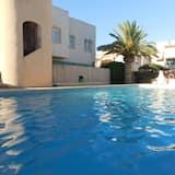 Bungalow en residencial con piscina