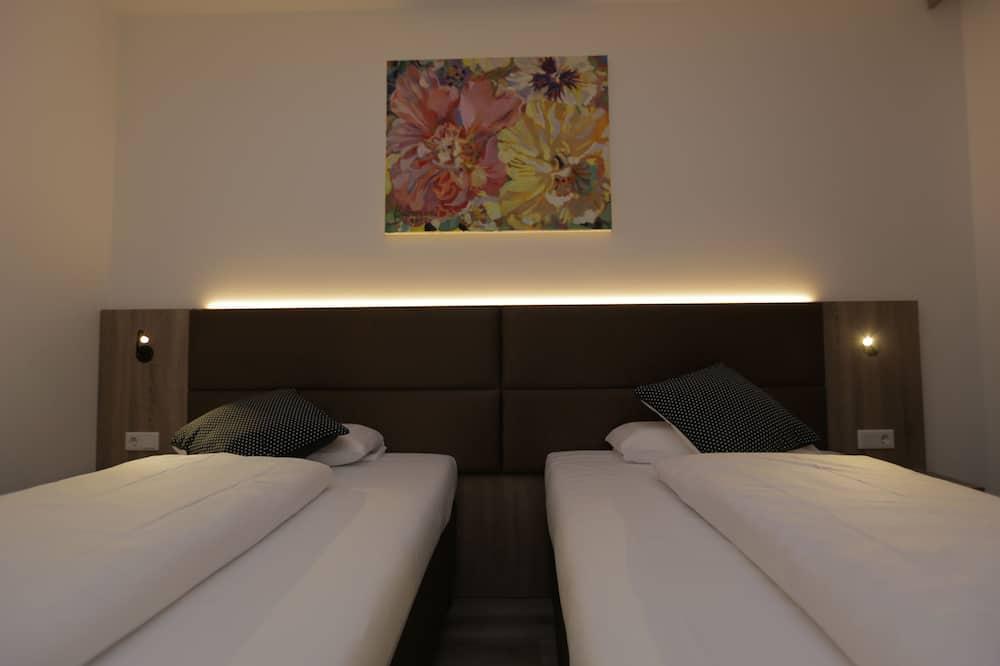 Izba typu Economy s dvojlôžkom alebo oddelenými lôžkami - Hosťovská izba