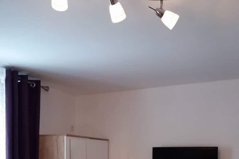 Deluxe kamer, 1 twee- of 2 eenpersoonsbedden - Woonruimte