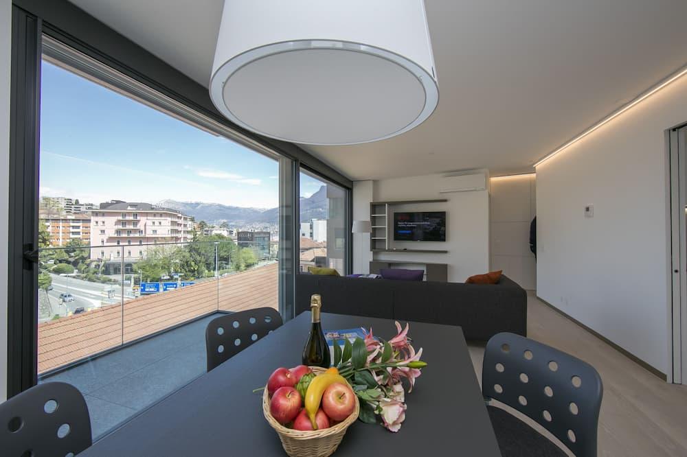Familienapartment, Mehrere Betten (Urban Flat Paradiso) - Essbereich im Zimmer
