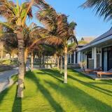 Camera con 2 letti singoli, vista spiaggia (Bungalow) - Vista giardino