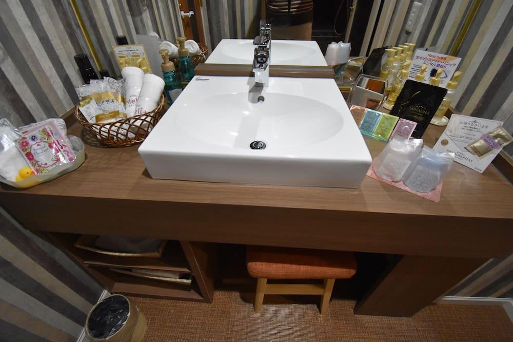 Habitación doble Deluxe - Lavabo en el baño