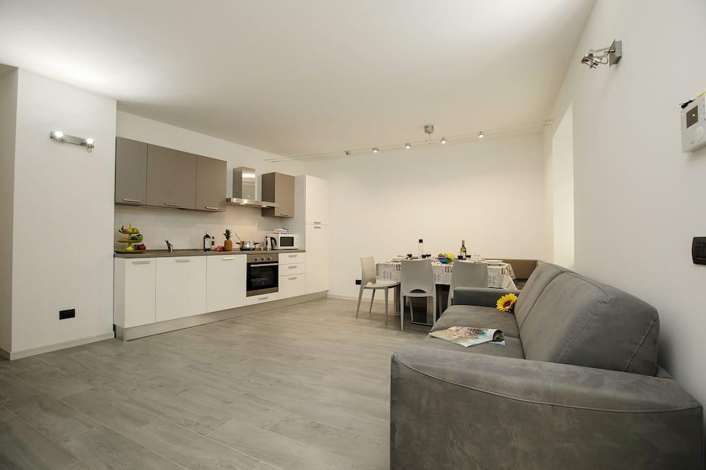 Rodinný apartmán, více lůžek (Appartamento Arco Varignano) - Obývací pokoj
