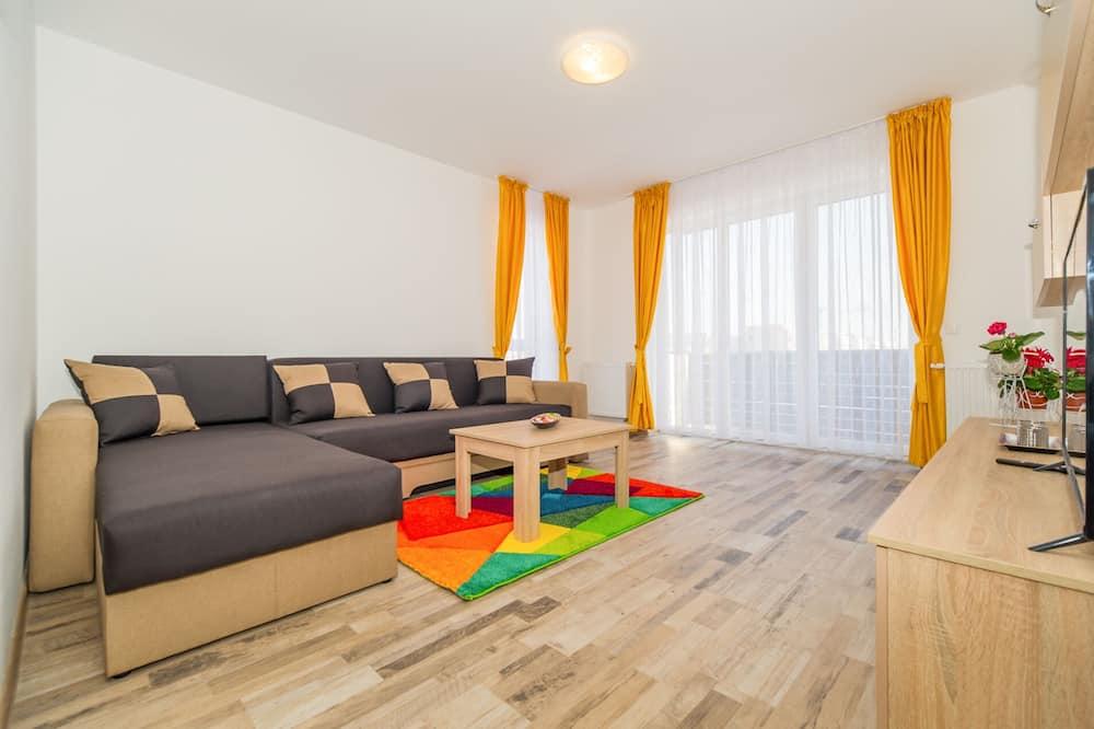 Departamento junior, balcón - Sala de estar