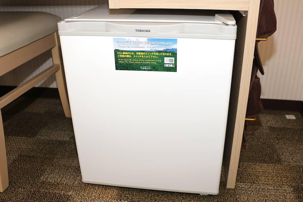 Стандартный двухместный номер с 2 односпальными кроватями, для некурящих - Мини-холодильник