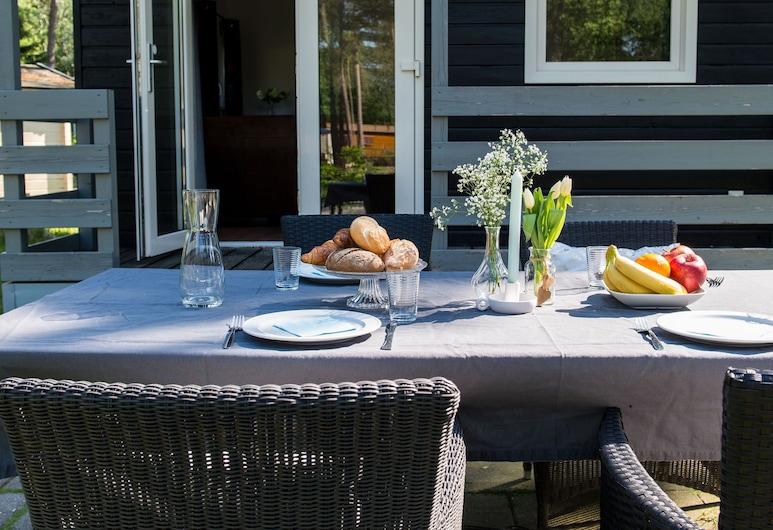 Likeable Chalet With a Terrace Near Oisterwijkse Vennen, اويسرفيك, حديقة