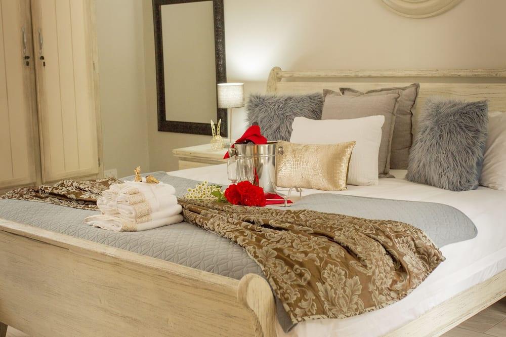 Darījumklases divvietīgs numurs, 1 divguļamā karaļa gulta, apsildāms kubuls - Viesu numurs
