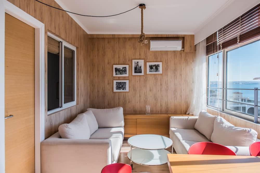 Апартаменти, 4 спальні, з видом на море - Вітальня
