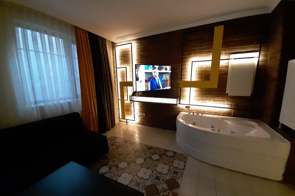 Романтический люкс, гидромассажная ванна, первый этаж - Зона гостиной