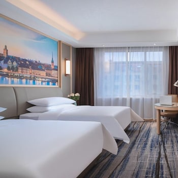 Image de Vienna International Hotel (Qingdao Liuting Airport High Speed Railway North Station) à Qingdao