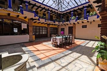 在圣克里斯多堡德拉斯卡萨斯的Capital O Hotel Cesars照片