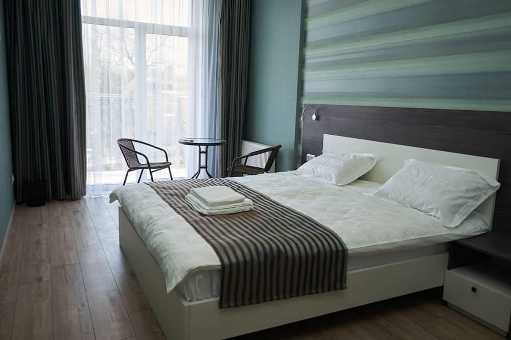 Standarta dzīvokļnumurs, 1 divguļamā karaļa gulta - Numurs