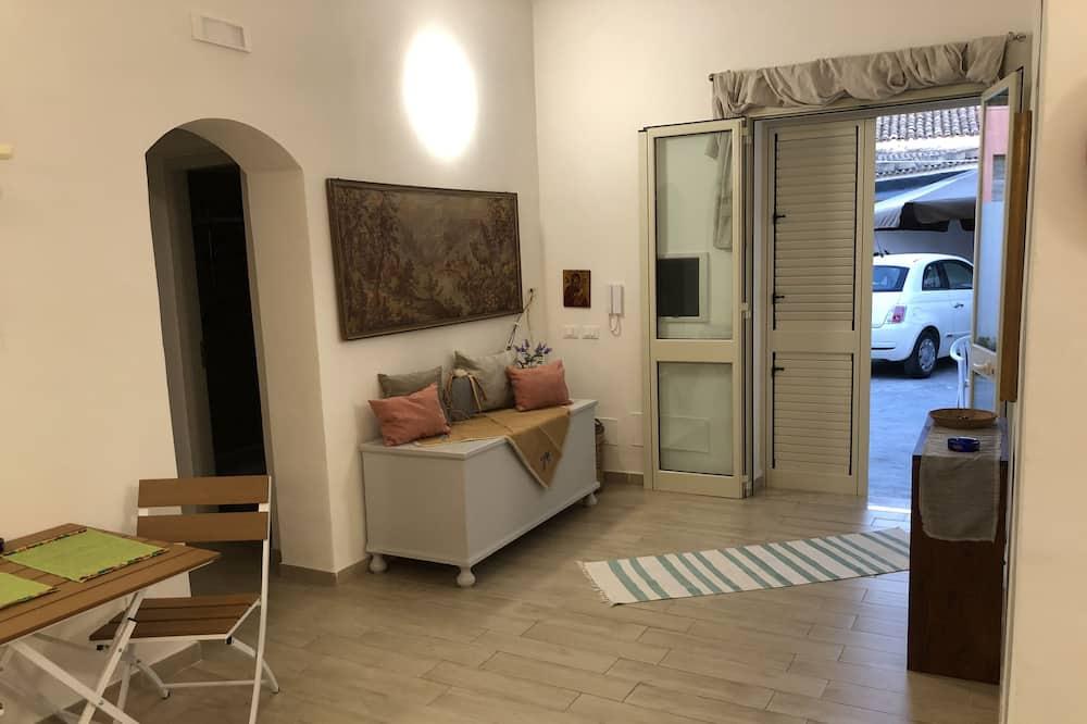 Стандартный двухместный номер с 1 двуспальной кроватью, общая ванная комната - Зона гостиной