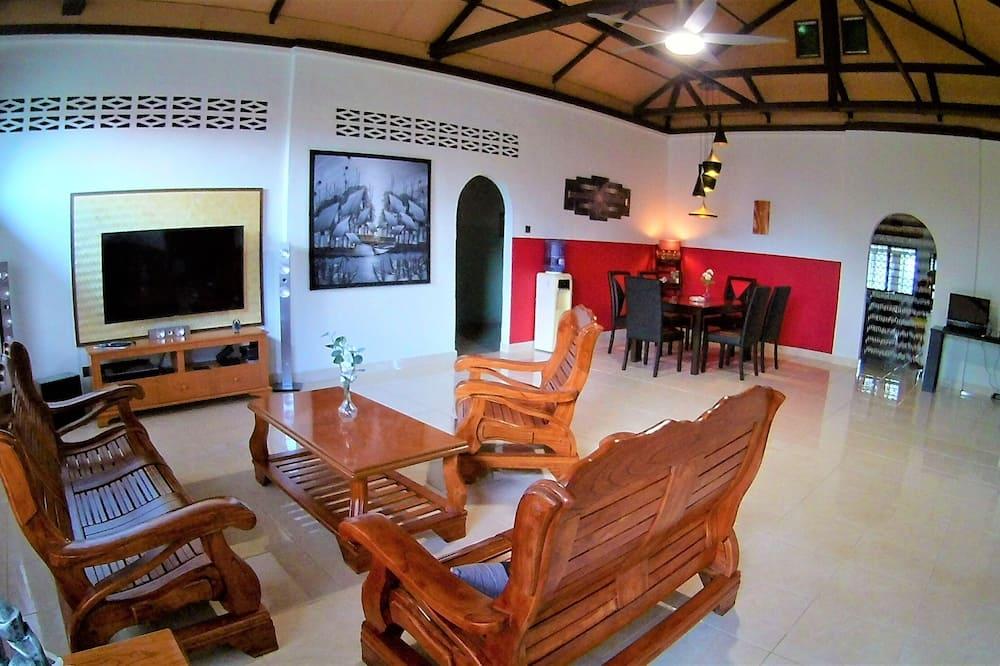 Deluxe-Doppel- oder -Zweibettzimmer, Mehrere Betten, Nichtraucher, Gartenblick - Wohnbereich