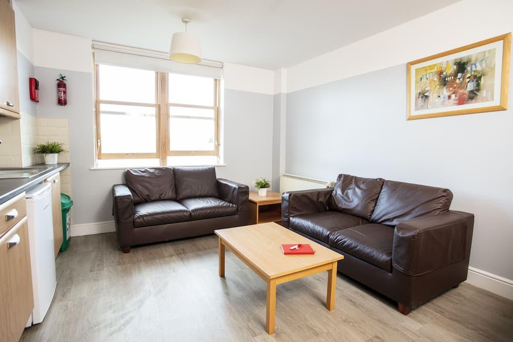 Apartamento City - Zona de estar