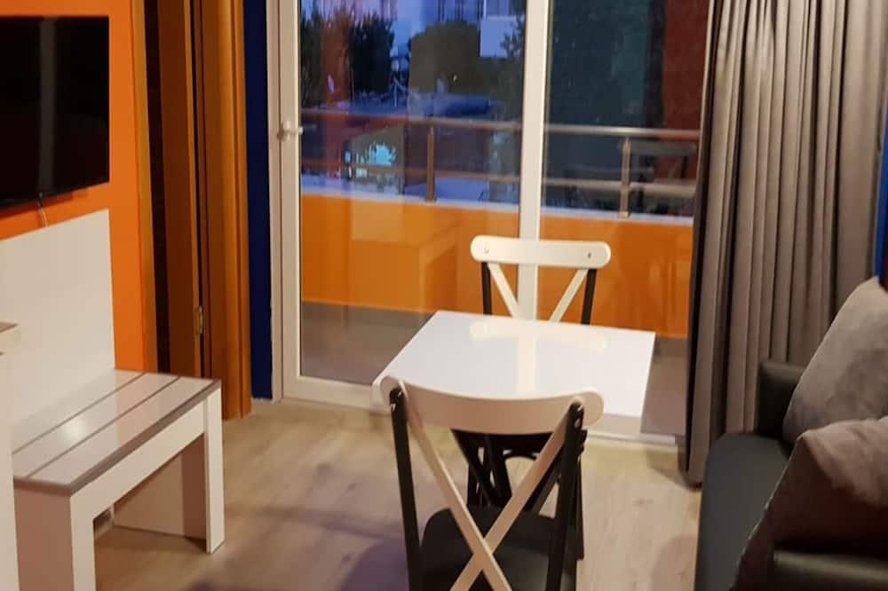 Economy appartement, Meerdere bedden - Eetruimte in kamer