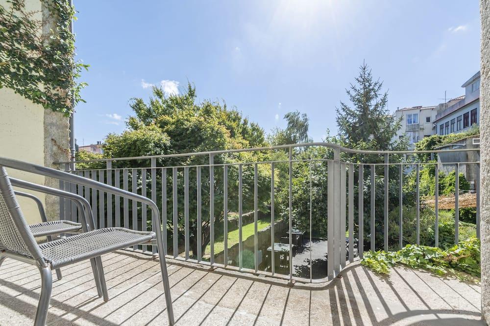Dvojlôžková izba typu Deluxe, výhľad na záhradu - Balkón