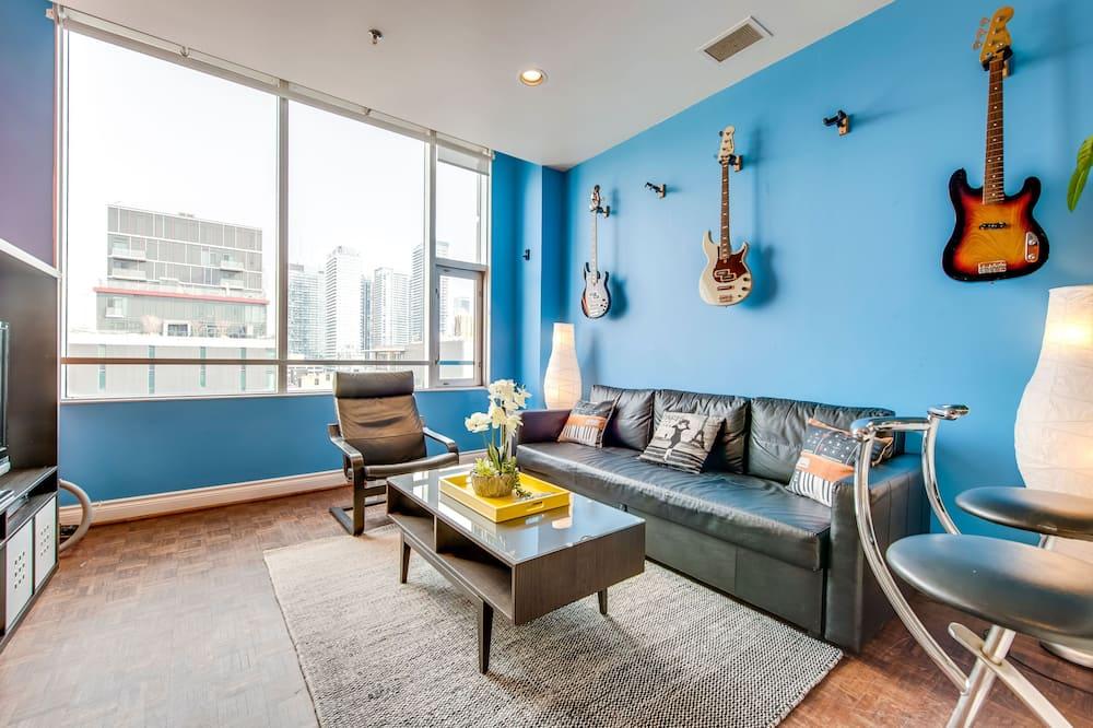 Executive-lejlighed - 1 soveværelse - køkken - Opholdsområde