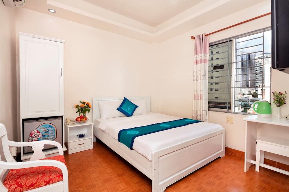 Habitación Deluxe con 1 cama doble o 2 individuales, vista a la ciudad - Sala de estar