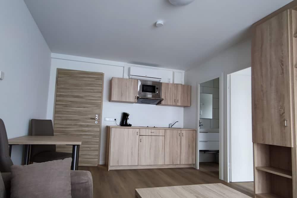 Comfort apartman, mozgássérültek számára is hozzáférhető, kilátással a városra - Nappali rész