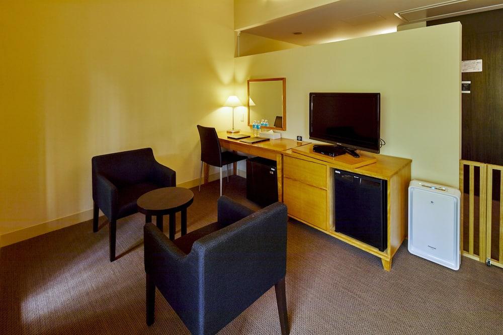 Chambre Standard avec lits jumeaux, non-fumeurs (Basic) - Coin séjour