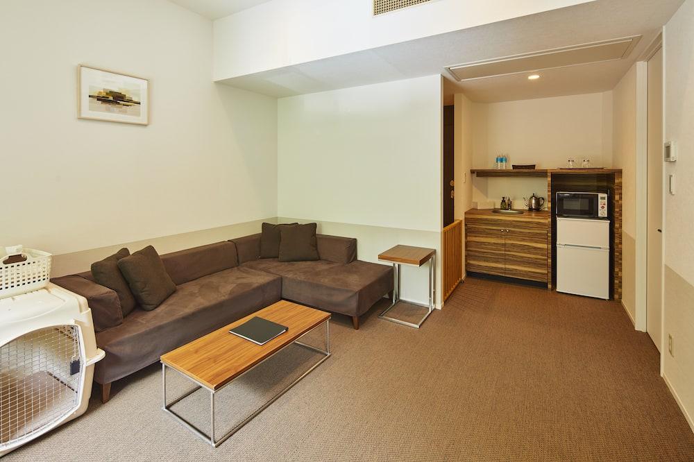 Chambre Deluxe avec lits jumeaux, non-fumeurs (Large Space) - Coin séjour