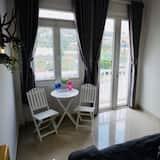 Deluxe-Vierbettzimmer - Wohnzimmer