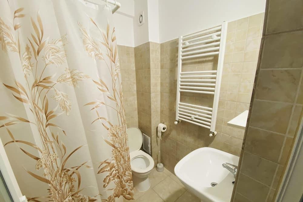 Izba typu Comfort, balkón, výhľad na záhradu - Kúpeľňa