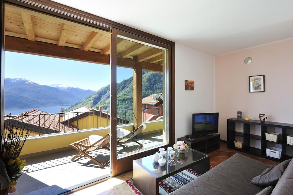 Departamento familiar, Varias camas, 2 baños, junto a la montaña (Borgo La Sorgente - Lavanda) - Sala de estar