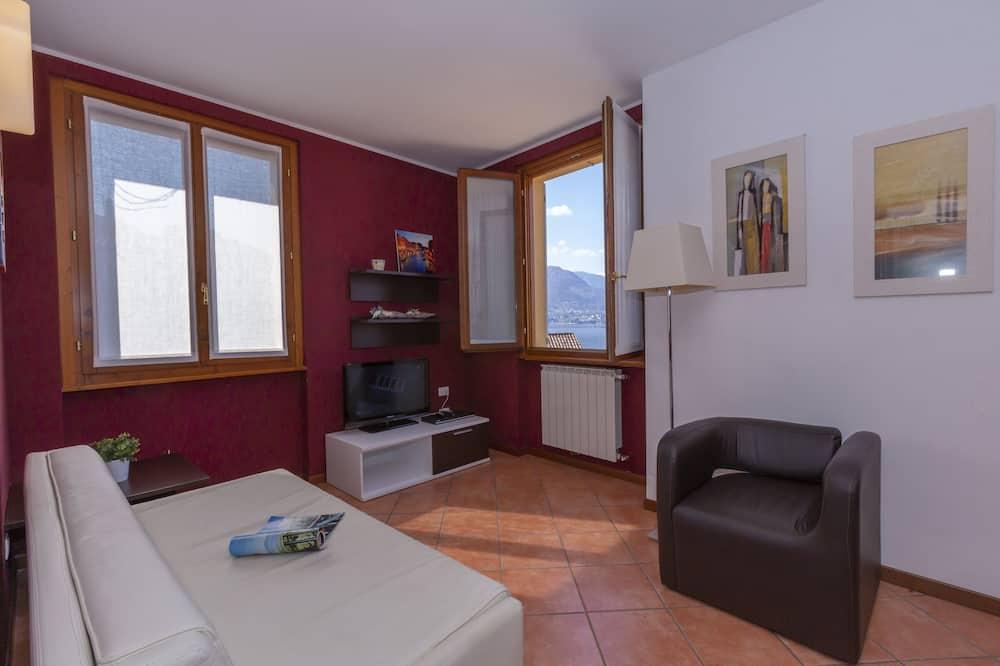 Apartemen Keluarga, 1 Tempat Tidur Double dengan tempat tidur Sofa (Fontana Del Lago Apt. 12) - Ruang Keluarga