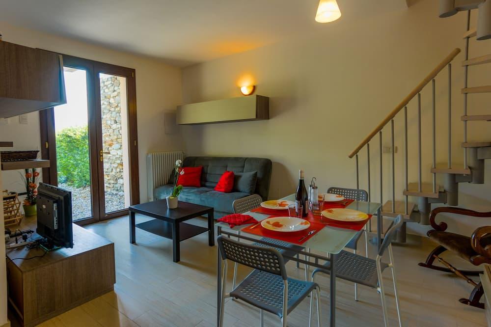 Honeymoon külaliskorter, 1 kahevoodi ja diivanvoodi, asukoht aias / aiapoolne (Bellavista Bellano) - Elutuba