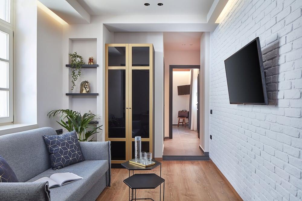 Deluxe Suite, 1 Bedroom - Living Area