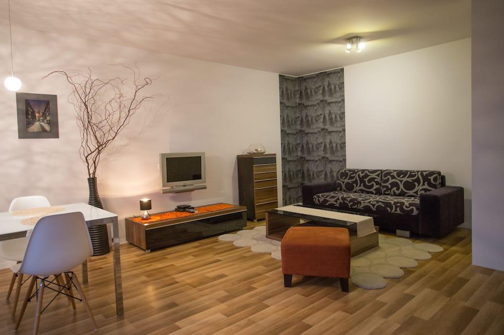 Comfort Apartment, Garden View - Living Room