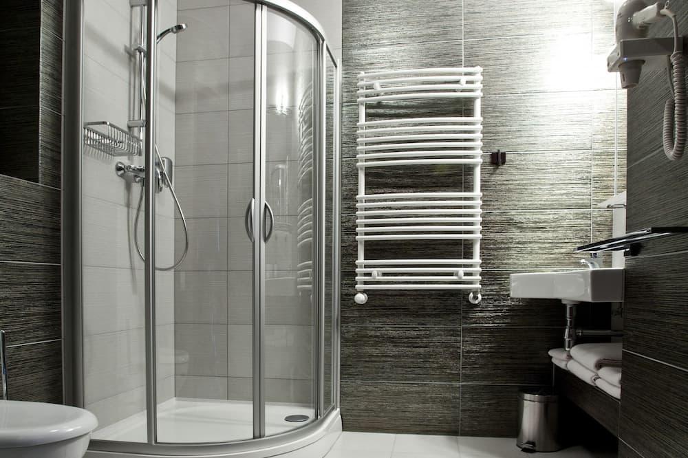 デラックス ダブルまたはツインルーム - バスルーム