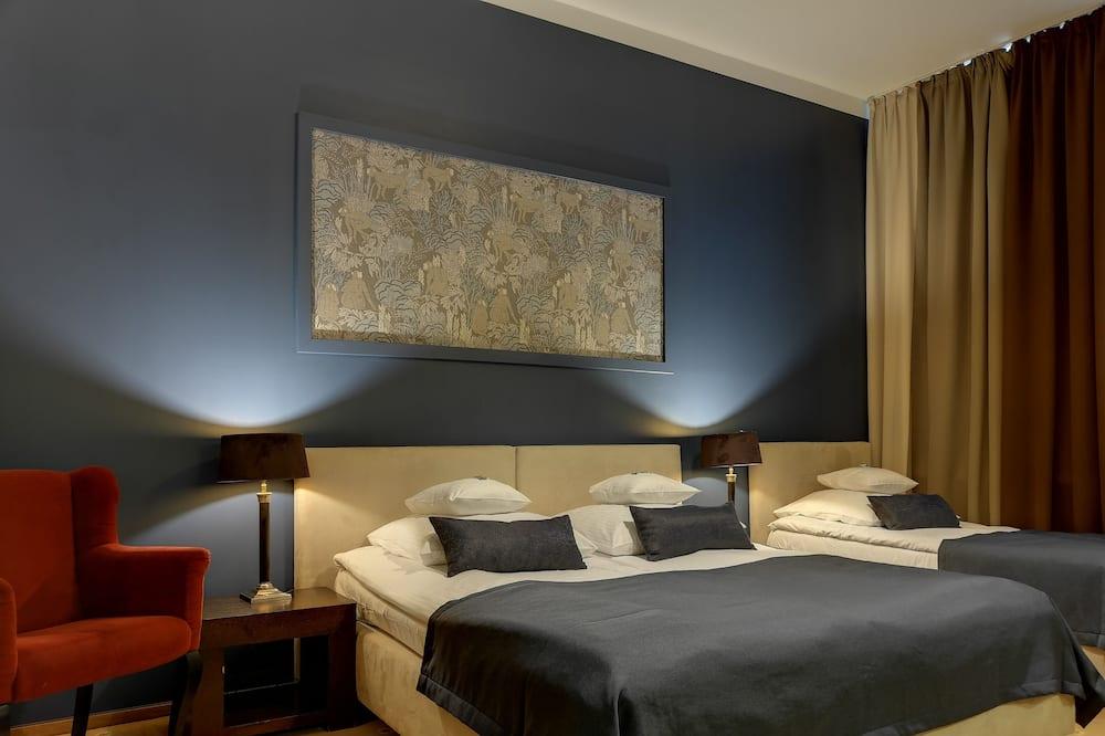 Standardní třílůžkový pokoj - Obývací prostor