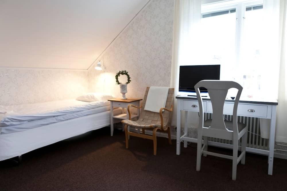 Standardenkeltværelse - 1 enkeltseng - udsigt til gårdsplads - Opholdsområde