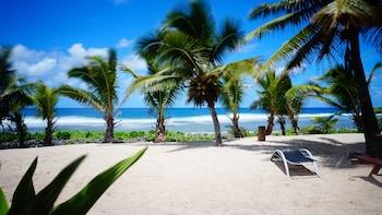 拉洛東加日出海灘小屋的圖片