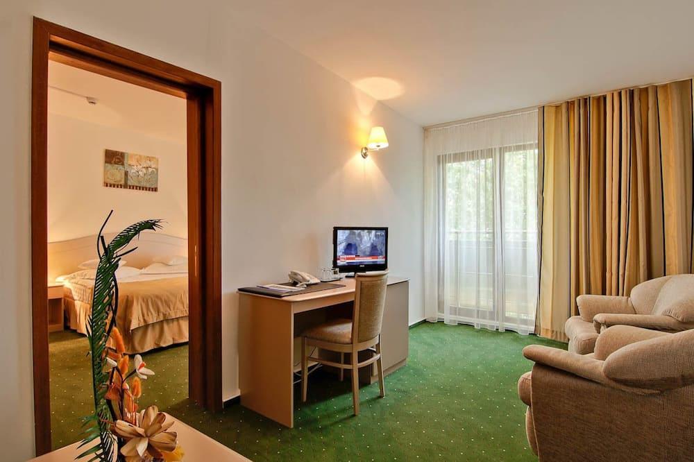 Apartamento superior - Sala de estar