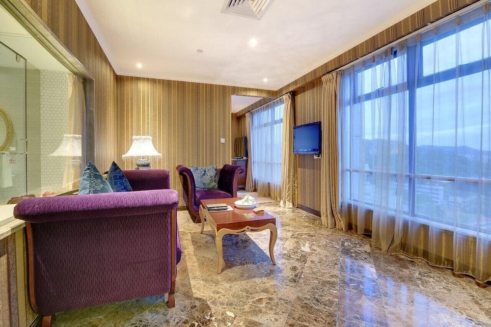 Suite Deluxe, vista al mar - Sala de estar