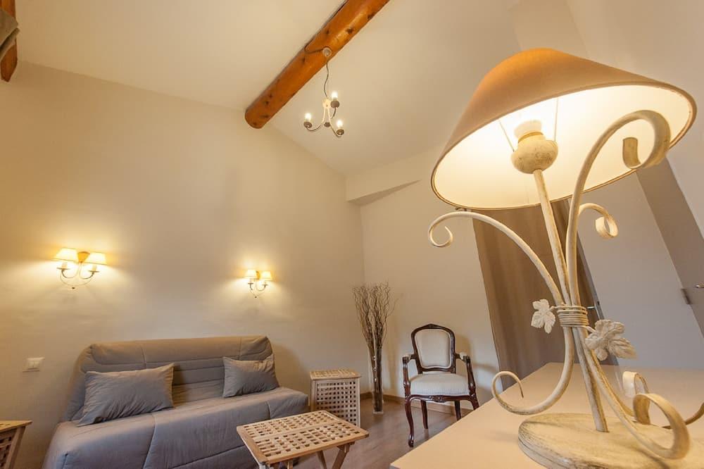 Suite Confort, 1 grand lit et 1 canapé-lit - Coin séjour